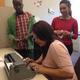 Joslyn making Braille nametags