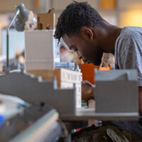 student building a model