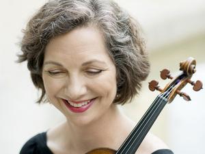 Violaine Melancon holding her violin and smiling