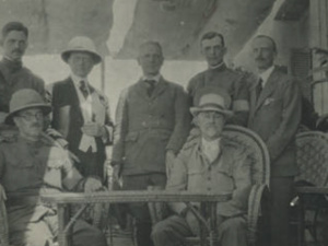 black and white photo graph of group of men standing and sitting.