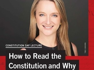 blond woman smiling on poster advertising Constitution Day lecture