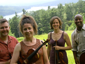 Apple Hill String Quartet members holding their stringed instruments.