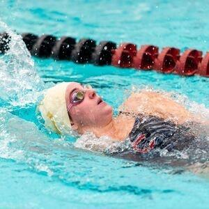Colgate swimmer doing the backstroke