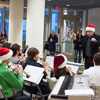 Brass concert and a few players wearing santa hats