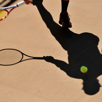 The shadow of a tennis player