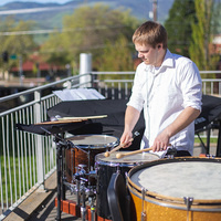 Mitchell Carlstrom playing drums during Oregon Fringe Festival