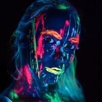 A woman wearing glow in the dark body paint