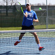 USI player about to hit a tennis ball over the net