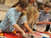 2019 Kids in the Kitchen Class participants making kebabs
