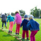 children going through obstacle course outside