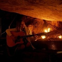 Live music, food, and drink in each cave room