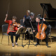 Argenta Trio performing onstage.