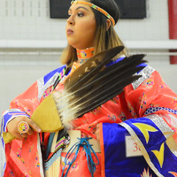 A woman dressed in Native American gear.