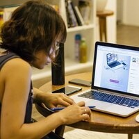 Young woman using online tools for learning