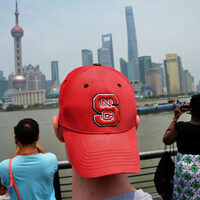 A picture of a student wearing an NC State University cap.