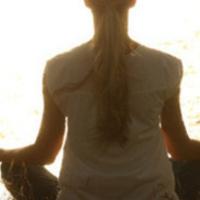 Photo of an individual meditating.