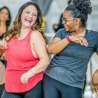 A picture of two women at Zumba class.