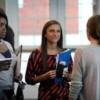 Students networking with employers at event